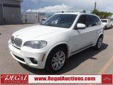 Photo of White 2011 BMW X5