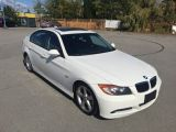 Photo of White 2006 BMW 323i