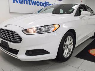 Used 2015 Ford Fusion SE in Stunning white ready for a fight for sale in Edmonton, AB