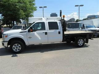 Used 2015 Ford F-350 4x4 diesel SRW with 9 ft flat deck for sale in Richmond Hill, ON