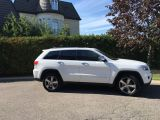 Photo of White 2015 Jeep Grand Cherokee
