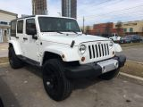 2013 Jeep Wrangler Unlimited Sahara with Lift Rockstar Wheels