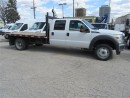Used 2012 Ford F-550 Crew Cab 4x4 gas chassis with 12 ft flat deck for sale in Richmond Hill, ON