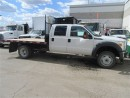 Used 2013 Ford F-550 Crew Cab 4x4 gas chassis with 12 ft flat deck for sale in Richmond Hill, ON