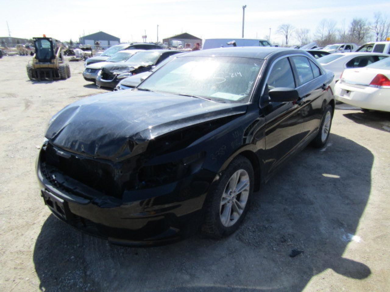 Photo of Black 2015 Ford Taurus