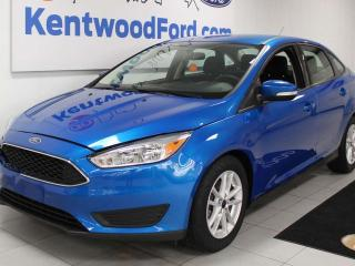 Used 2017 Ford Focus SE FWD with a back up cam all in royal blue for sale in Edmonton, AB