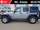 Used 2014 Jeep Wrangler UNLIMITED SPORT for sale in Red Deer, AB