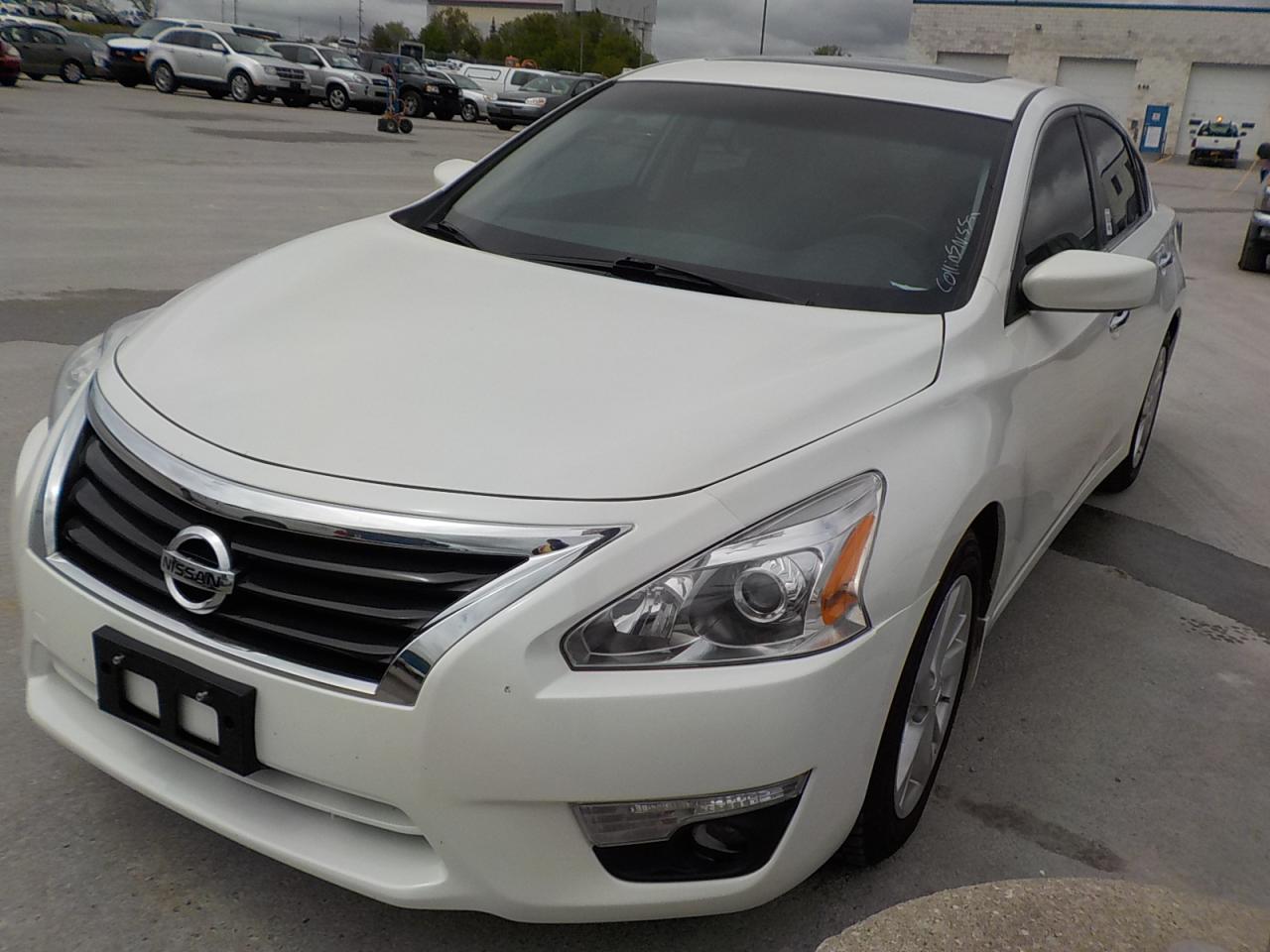 Photo of White 2015 Nissan ALTIMA SV