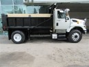 Used 2011 International Workstar7400 with 12 ft custom heated steel dump box for sale in Richmond Hill, ON