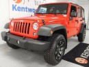 Used 2016 Jeep Wrangler Unlimited Sport Unlimited Trail rated in a flashy sporty red for sale in Edmonton, AB