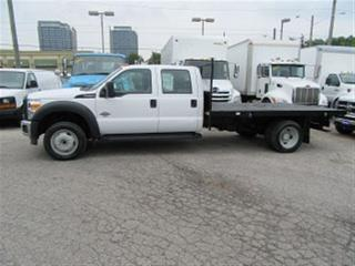 Used 2015 Ford F-550 Diesel Crew Cab 4x4 with 12 ft flat deck for sale in Richmond Hill, ON