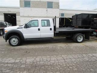 Used 2015 Ford F-550 Crew Cab 4x4 gas with 12 ft flat deck for sale in Richmond Hill, ON