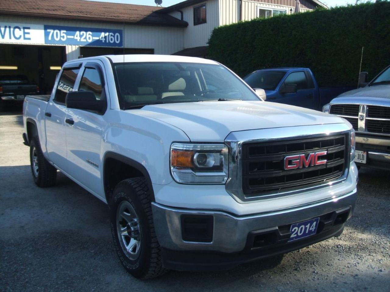 Photo of White 2014 GMC Sierra 1500