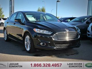 Used 2014 Ford Fusion SE AWD - Local 2nd Owner Trade In | No Accidents | Leather Interior | Heated Seats | Bluetooth | Parking Sensors | 18 Inch Wheels | Climate Control with AC | Low KMs | Spacious Trunk | Great Fuel Mileage | Factory Warranty Remaining for sale in Edmonton, AB