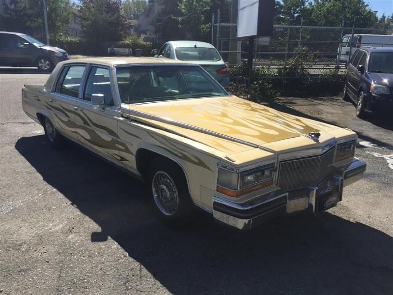 Photo of Yellow 1985 Cadillac Fleetwood