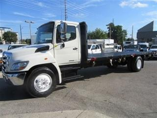 Used 2012 Hino 268 Diesel with custom 24 ft steel flat deck for sale in Richmond Hill, ON
