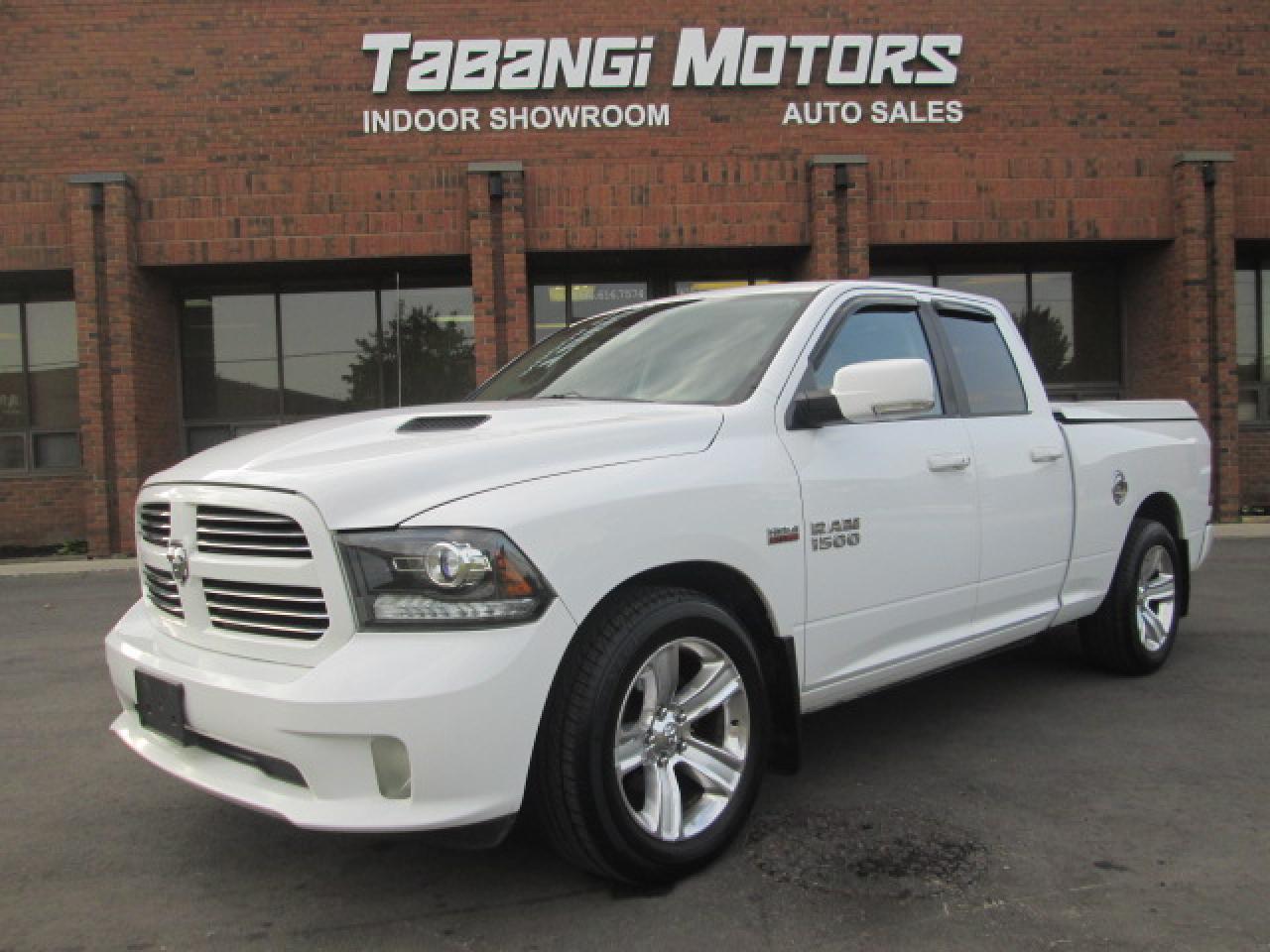 Photo of White 2014 Dodge Ram 1500