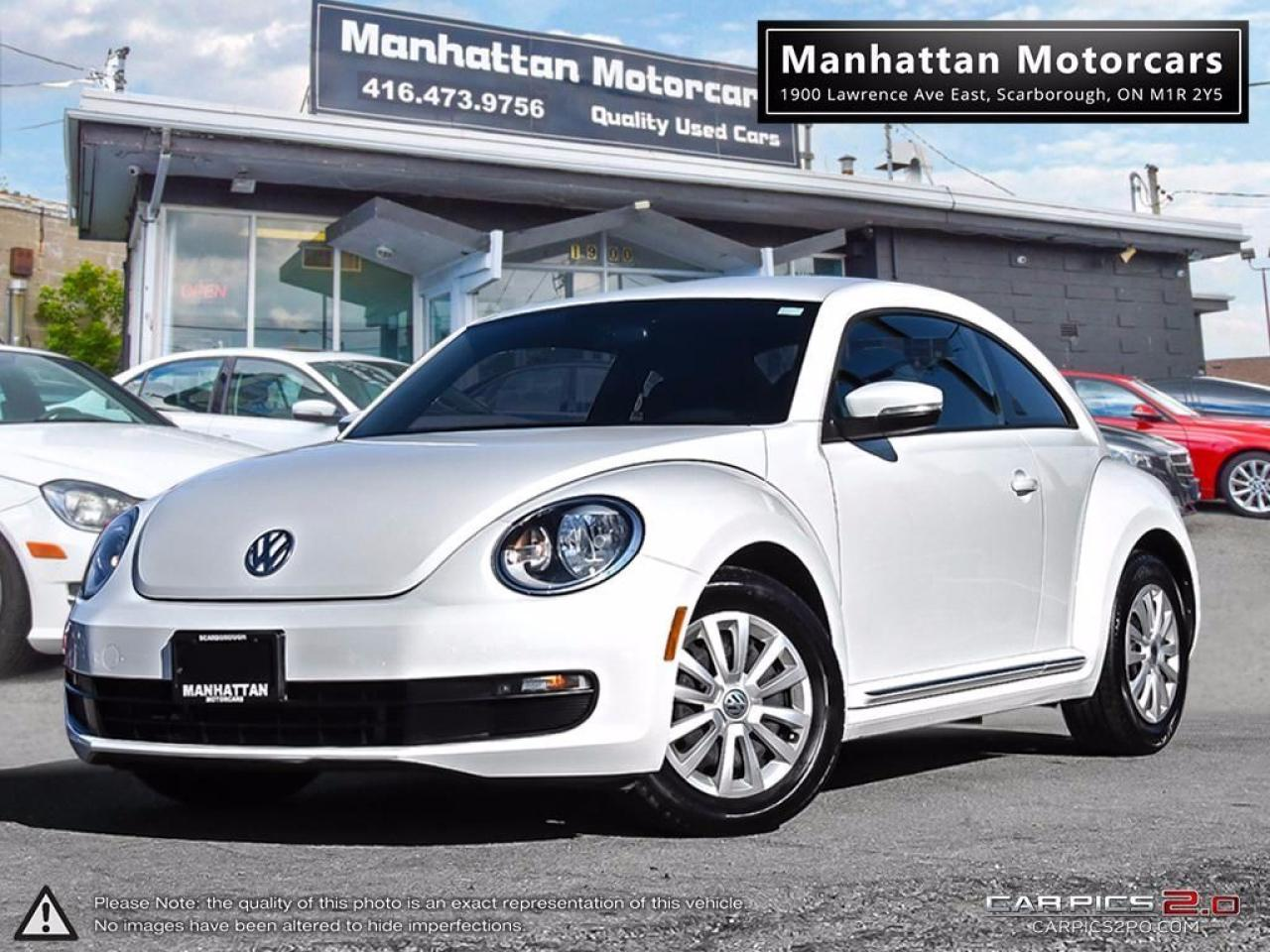 Photo of White 2016 Volkswagen Beetle