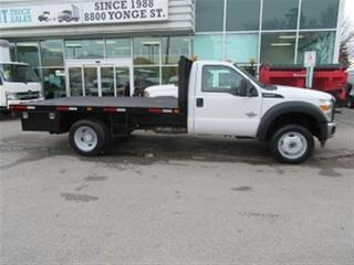 Used 2015 Ford F-550 Reg Cab 4x4 diesel with custom 12 ft flat deck for sale in Richmond Hill, ON