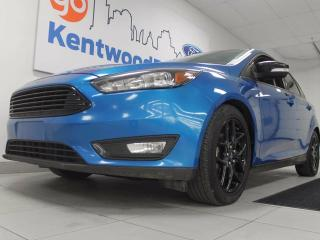 Used 2015 Ford Focus SE manual hatchback with back up cam and keyless entry in a candy blue for sale in Edmonton, AB