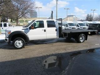 Used 2012 Ford F-550 Crew Cab 4x4 diesel with 12 ft flat deck for sale in Richmond Hill, ON