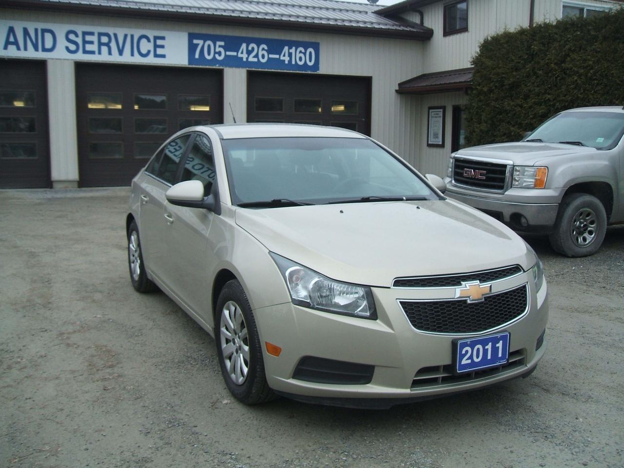 Photo of Beige 2011 Chevrolet Cruze