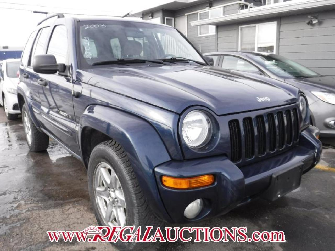 Photo of Blue 2003 Jeep Liberty
