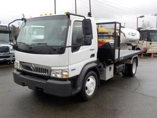 Used 2009 International CF 600 Diesel Tilting Flat Deck for sale in Burnaby, BC