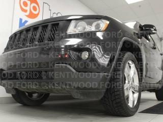 Used 2013 Jeep Grand Cherokee Overland with heated power leather seats, sunroof, back up cam, terrain controls and heated rear seats with DVD entertainment on both sides for sale in Edmonton, AB