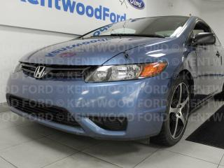 Used 2008 Honda Civic DXG 5-SPD manual in baby blue, but don't let that fool you. There's no baby engine for sale in Edmonton, AB