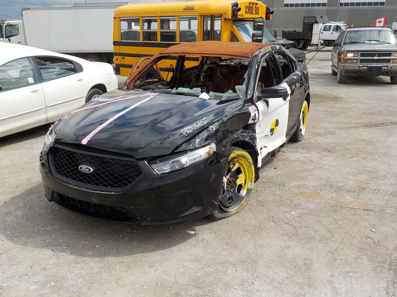Photo of Black 2013 Ford Taurus