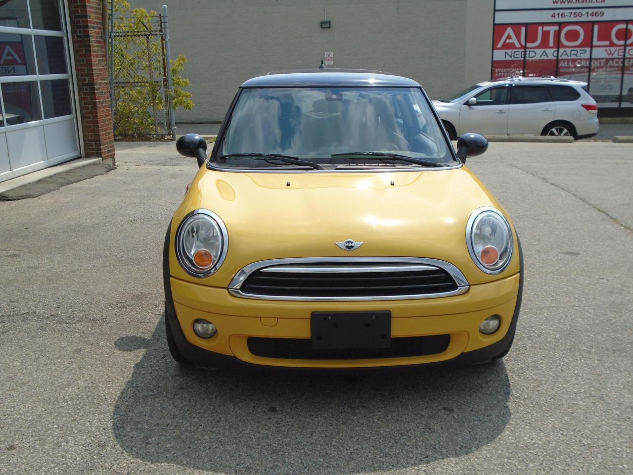Photo of Yellow 2009 MINI Cooper Coupe