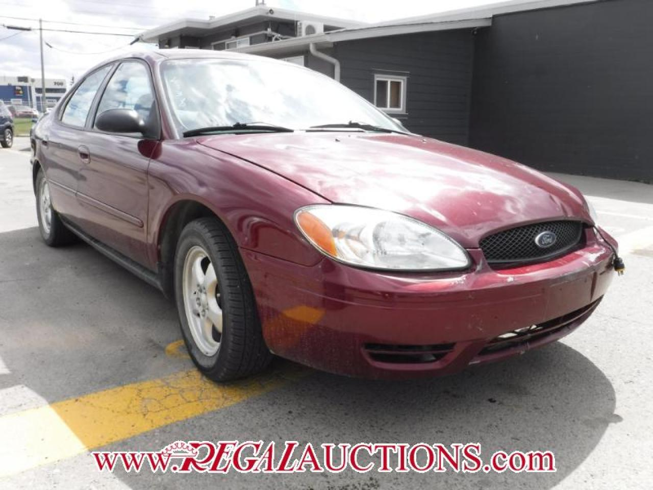 Photo of Red 2005 Ford TAURUS SE 4D SEDAN