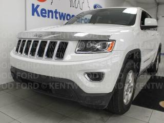 Used 2015 Jeep Grand Cherokee Laredo 4x4 in bright white with a power drivers seat and push start/stop for sale in Edmonton, AB
