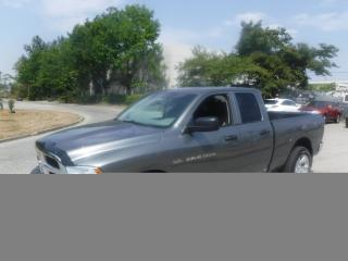 Used 2012 RAM 1500 ST Quad Cab 4WD for sale in Burnaby, BC