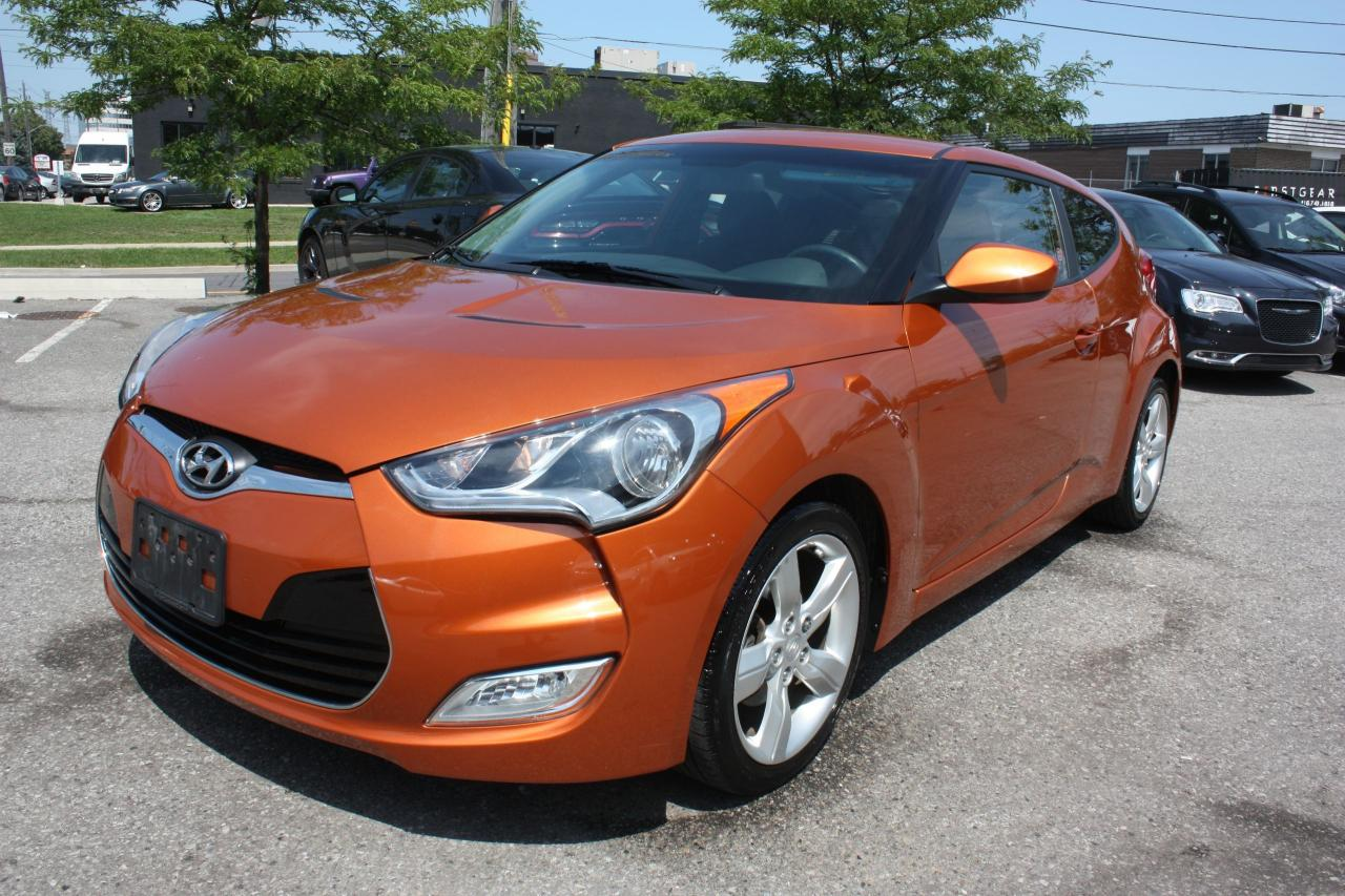 Photo of Orange 2013 Hyundai Veloster