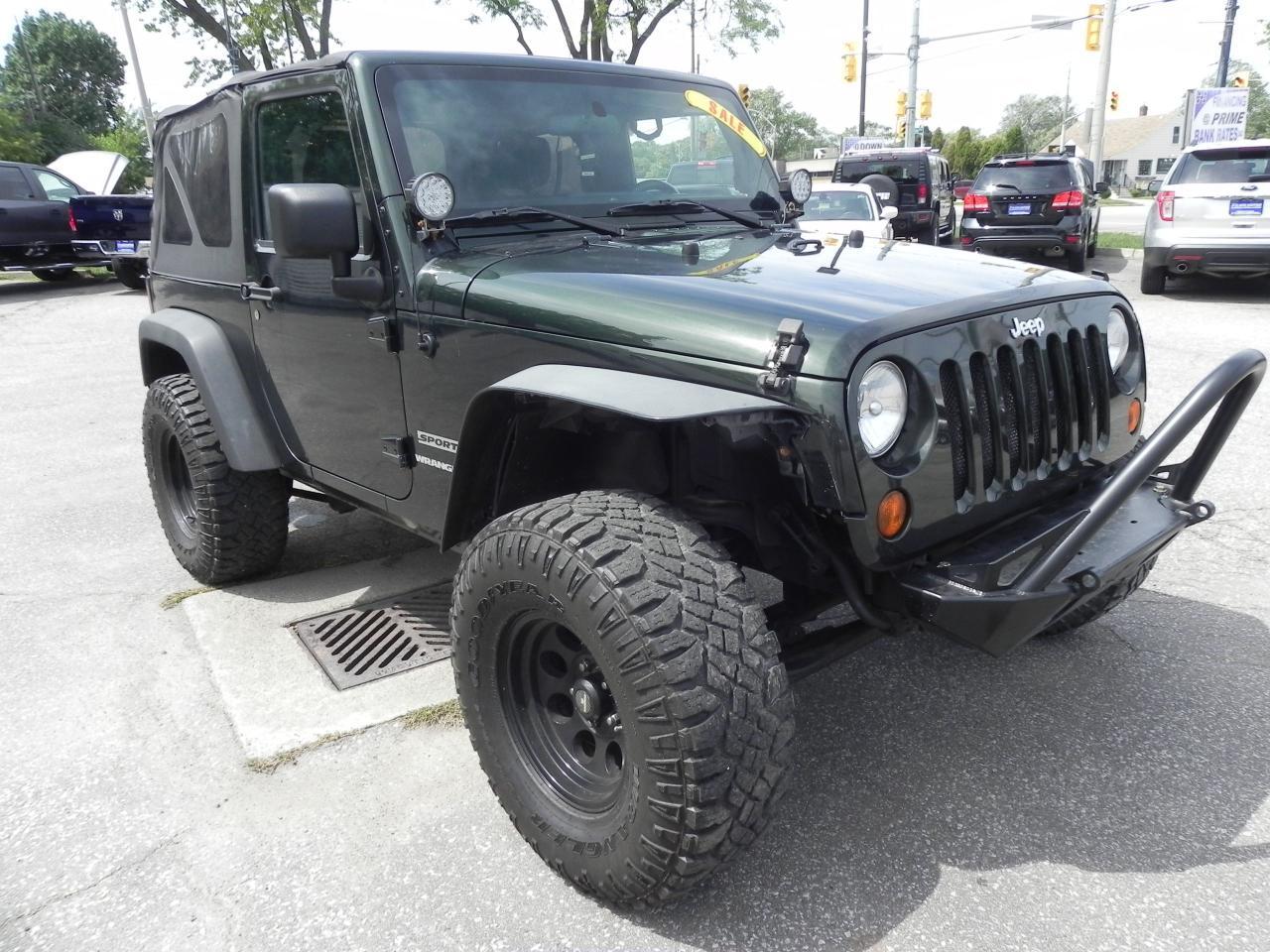 Photo of Dark Green 2011 Jeep Wrangler