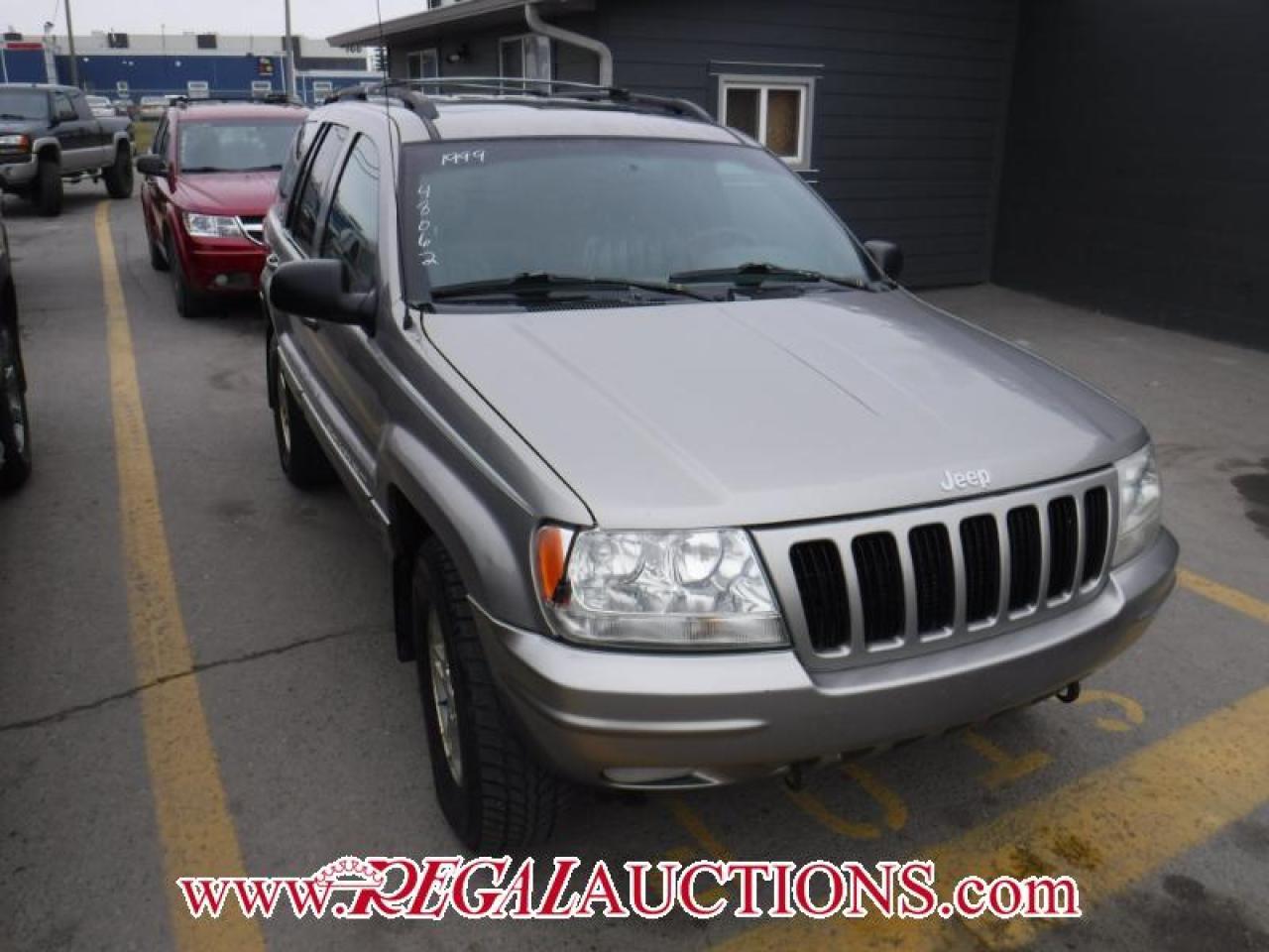 Photo of Grey 1999 Jeep Grand Cherokee