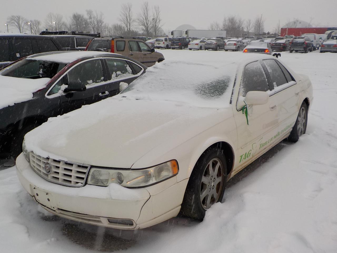 Photo of White 2003 Cadillac Seville
