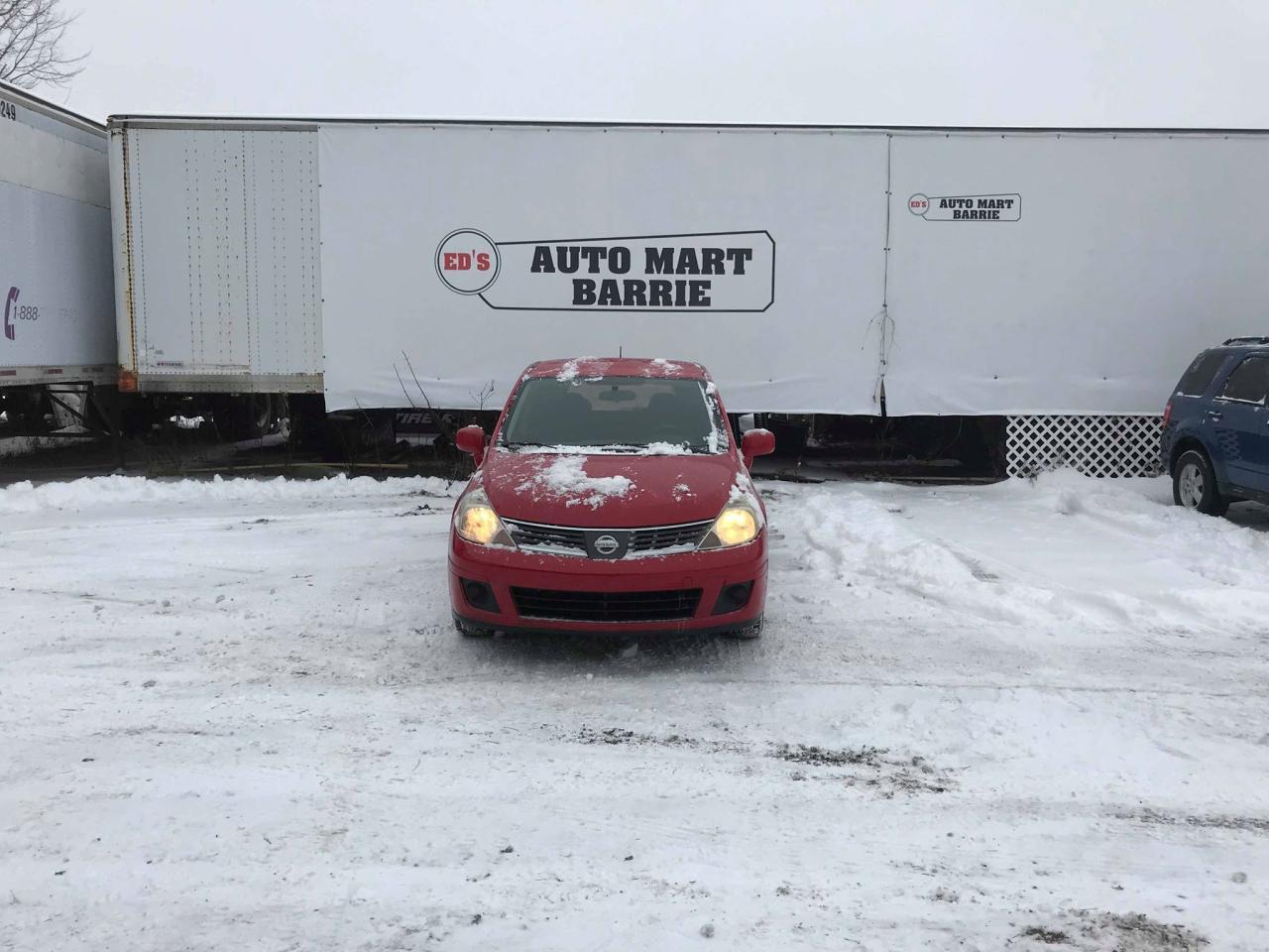 Photo of Red 2009 Nissan Versa