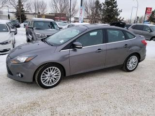 Used 2014 Ford Focus TITANIUM; KEYLESS ENTRY, BACKUP CAM, HEATED SEATS, BLUETOOTH AND MORE for sale in Edmonton, AB