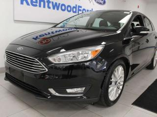 Used 2018 Ford Focus Titanium FWD hatch with a sunroof, heated seats, heated steering wheel, back up cam for sale in Edmonton, AB