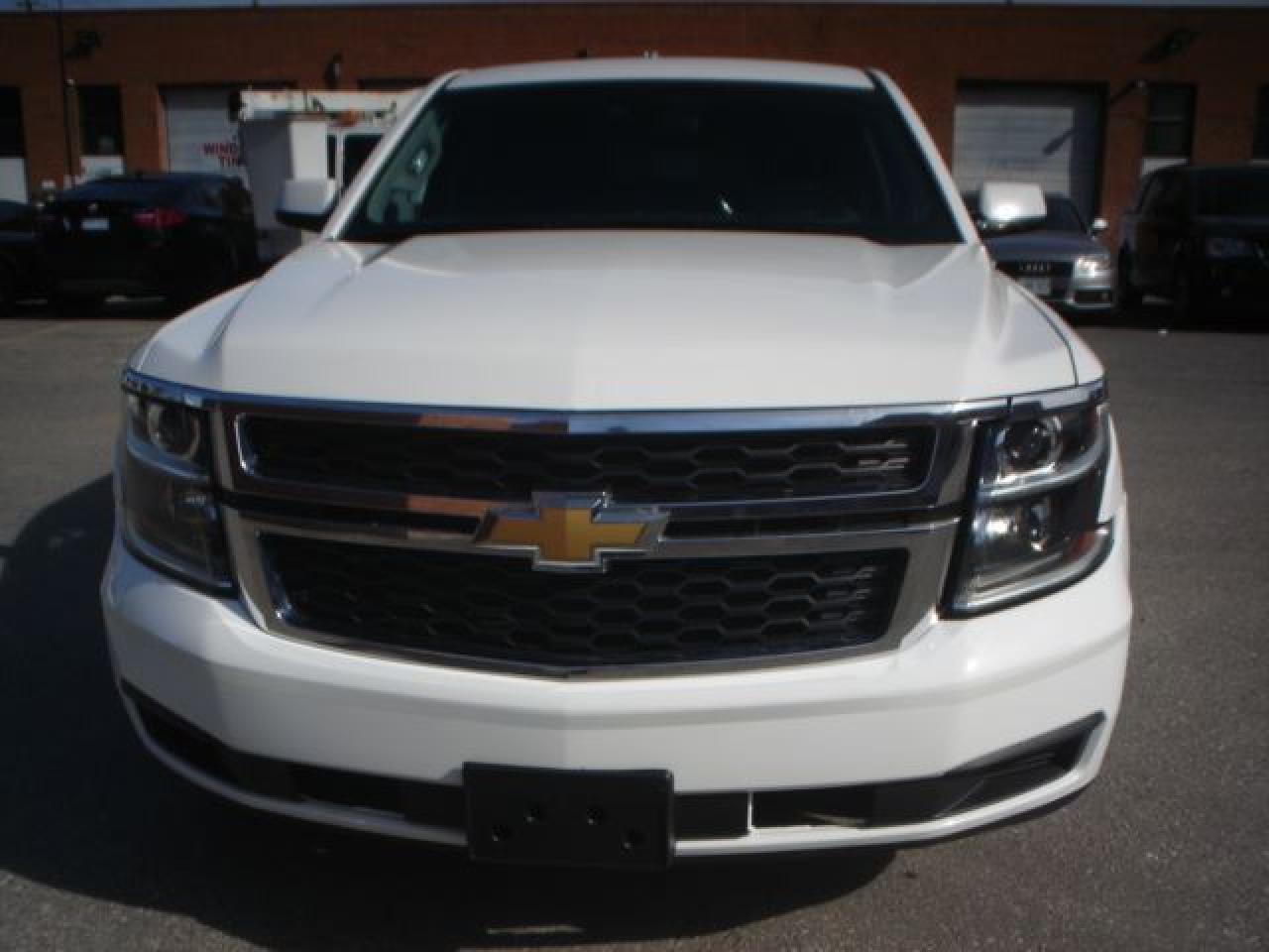 Photo of White 2015 Chevrolet Tahoe