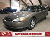 Photo of Gold 2003 Ford Taurus