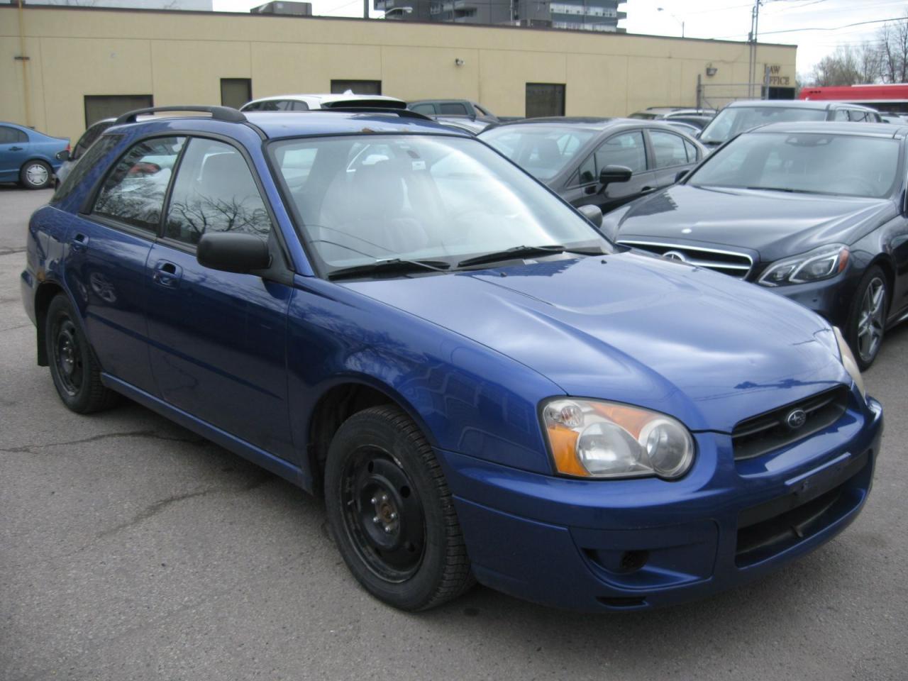 Photo of Blue 2004 Subaru Impreza