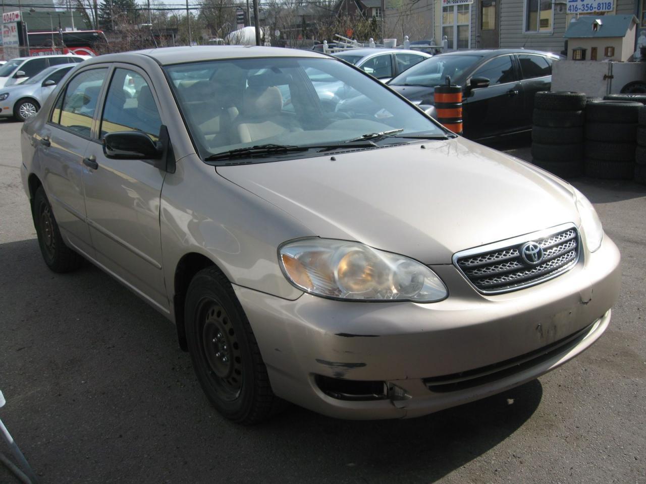 Photo of Gold 2008 Toyota Corolla