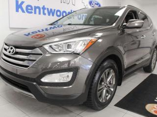 Used 2014 Hyundai Santa Fe Sport Luxury AWD with power heated seats, sunroof, and back up camera for sale in Edmonton, AB