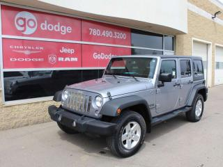 Used 2014 Jeep Wrangler UNLIMITED SPORT for sale in Edmonton, AB