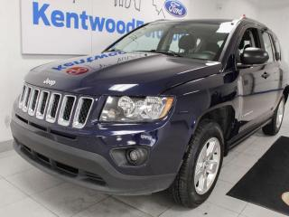 Used 2015 Jeep Compass Sport 5-SPD FWD in a gorgeous dark blue for sale in Edmonton, AB