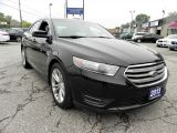 Photo of Black 2013 Ford Taurus